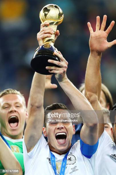 Julian Draxler of Germany lifts the FIFA Confederations Cup trophy after the FIFA Confederations Cup Russia 2017 Final between Chile and Germany at...