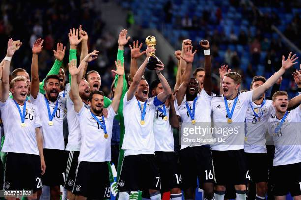 Julian Draxler of Germany lifts the FIFA Confederations Cup trophy after the FIFA Confederations Cup Russia 2017 Final match between Chile and...