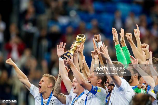 Julian Draxler of Germany lifts the trophy after the FIFA Confederations Cup Russia final match between Chile and Germany at Saint Petersburg Stadium...