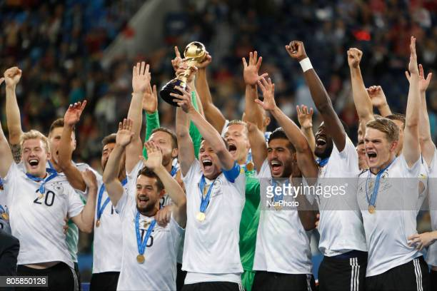 Julian Draxler of Germany national team lifts up the trophy as Germany national team players celebrate during award ceremony after FIFA...