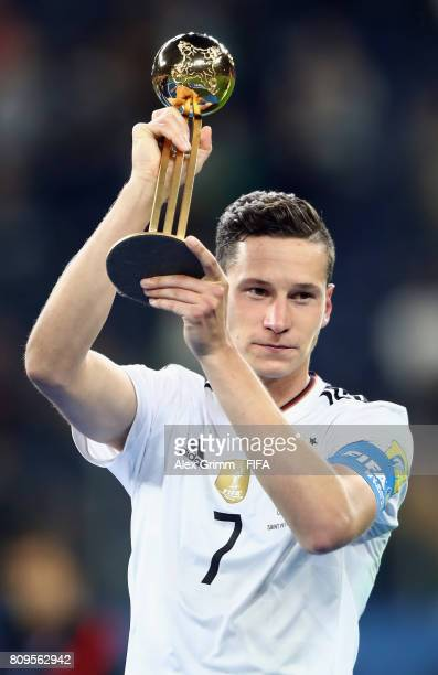 Julian Draxler of Germany poses with the adidas Golden Ball award after the FIFA Confederations Cup Russia 2017 final between Chile and Germany at...