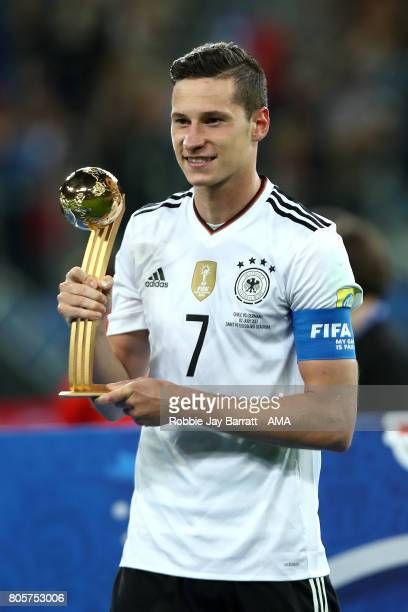 Julian Draxler of Germany poses with the trophy at the end of the FIFA Confederations Cup Russia 2017 Final match between Chile and Germany at Saint...