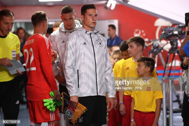 Julian Draxler of Germany prepares to lead his team out prior to the FIFA Confederations Cup Russia 2017 Group B match between Germany and Cameroon...
