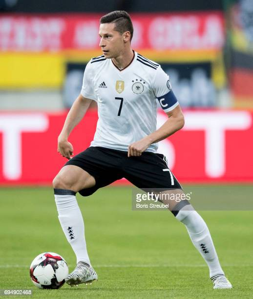 Julian Draxler of Germany runs with the ball during the FIFA 2018 World Cup Qualifier between Germany and San Marino at Stadion Nuernberg on June 10...