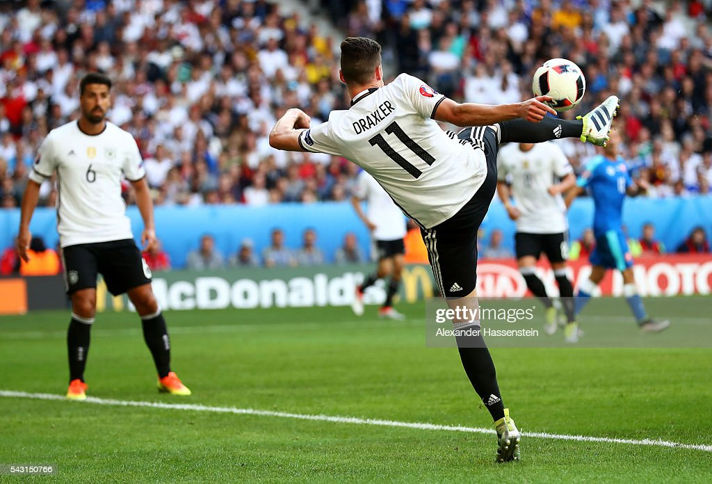<a gi-track='captionPersonalityLinkClicked' href=/galleries/search?phrase=Julian+Draxler&family=editorial&specificpeople=7184479 ng-click='$event.stopPropagation()'>Julian Draxler</a> of Germany scores his team's third goal during the UEFA EURO 2016 round of 16 match between Germany and Slovakia at Stade Pierre-Mauroy on June 26, 2016 in Lille, France.