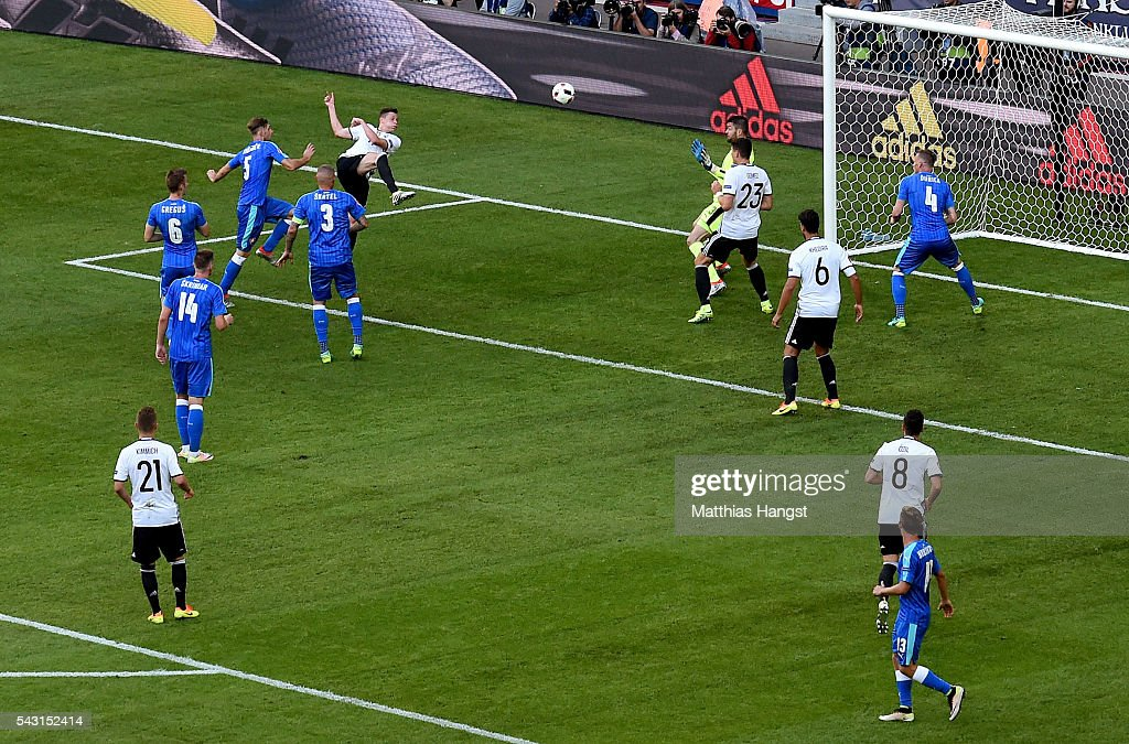 Julian Draxler (top) of Germany scores his team's third goal during the UEFA EURO 2016 round of 16 match between Germany and Slovakia at Stade Pierre-Mauroy on June 26, 2016 in Lille, France.