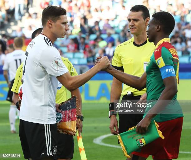 Julian Draxler of Germany shakes hands with Benjamin Moukandjo of Cameroon during the FIFA Confederations Cup Russia 2017 Group B match between...