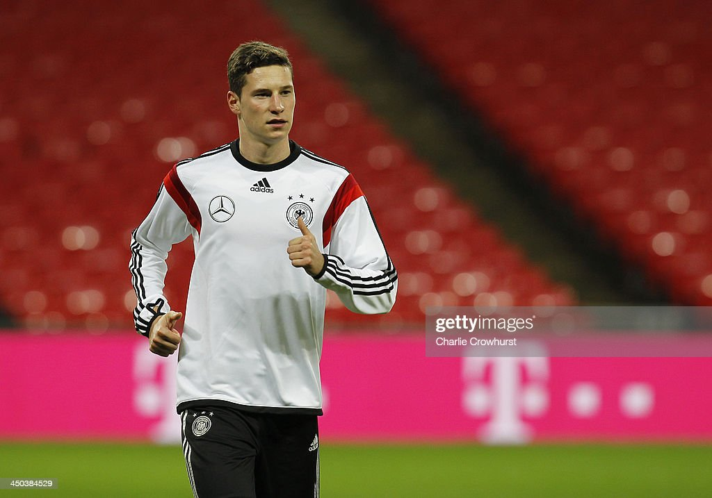<a gi-track='captionPersonalityLinkClicked' href=/galleries/search?phrase=Julian+Draxler&family=editorial&specificpeople=7184479 ng-click='$event.stopPropagation()'>Julian Draxler</a> of Germany warms up during a training session at Wembley Stadium ahead of their International Friendly against England on November 18, 2013 in London, England.