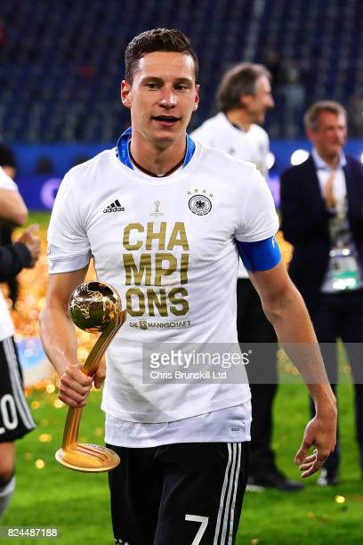 Julian Draxler of Germany with the player of the tournament trophy following the FIFA Confederations Cup Russia 2017 Final match between Chile and...