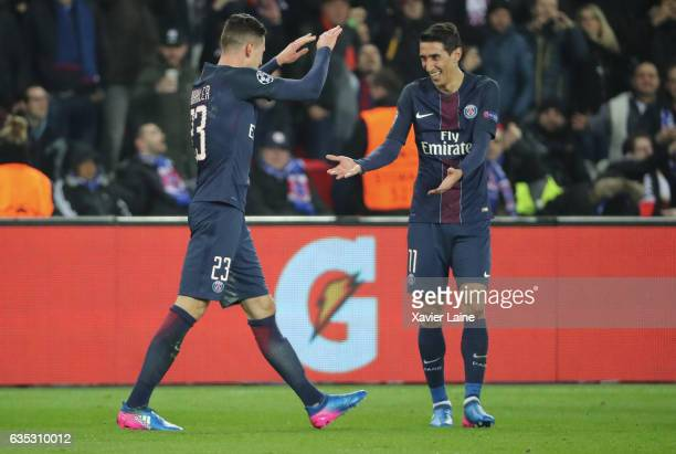 Julian Draxler of Paris SaintGermain celebrates his goal with Angel Di Maria during the UEFA Champions League Round of 16 first leg match between...