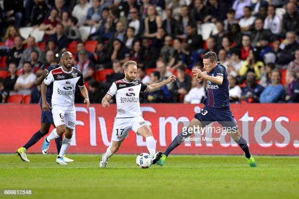 Julian Draxler of Paris SaintGermain fights for the ball during the Ligue 1 match between EA Guingamp and Paris SaintGermain at Parc des Princes on...