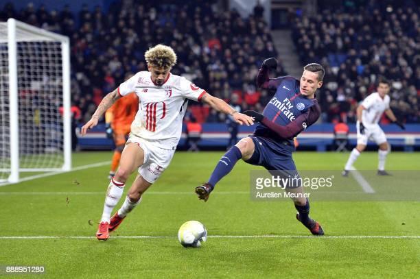 Julian Draxler of Paris SaintGermain fights for the ball during the Ligue 1 match between Paris Saint Germain and Lille OSC at Parc des Princes on...
