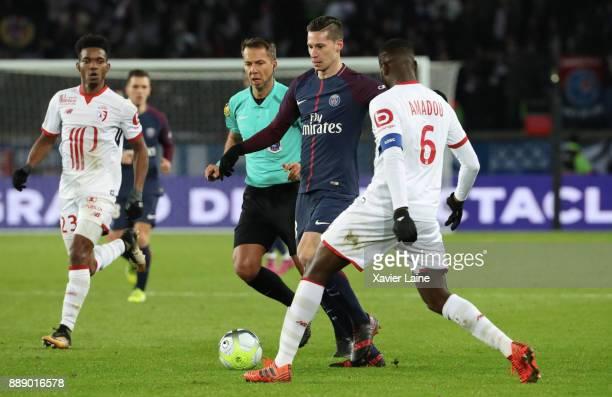 Julian Draxler of Paris SaintGermain in action during the Ligue 1 match between Paris Saint Germain and Lille OSC at Parc des Princes on December 9...