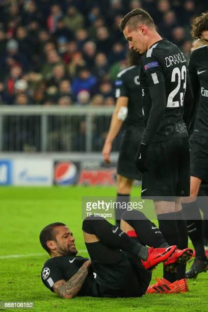 Julian Draxler of Paris SaintGermain looks on Dani Alves of Paris SaintGermain on the ground during the UEFA Champions League group B match between...