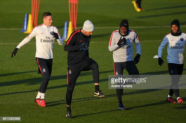 Julian Draxler of PSG and Blaise Matuidi of PSG and Lucas Moura of PSG during the Training Session of Paris Saint Germain at Camp des Loges on...