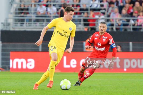 Julian Draxler of PSG and Cedric Varrault of Dijon during the Ligue 1 match between Dijon FCO and Paris Saint Germain at Stade Gaston Gerard on...
