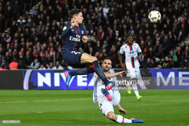 Julian Draxler of PSG and Jeremy Morel of Lyon during the French Ligue 1 match between Paris Saint Germain and Lyon at Parc des Princes on March 19...
