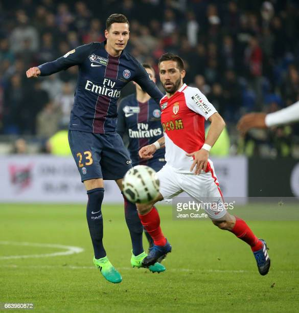 Julian Draxler of PSG and Joao Moutinho of Monaco during the French League Cup final between Paris SaintGermain and AS Monaco at Parc OL on April 1...