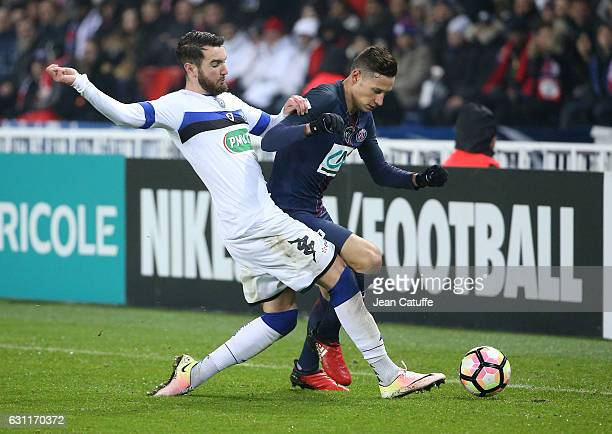 Julian Draxler of PSG and Mathieu Peybernes of Bastia in action during the French Cup match between Paris SaintGermain and SC Bastia at Parc des...