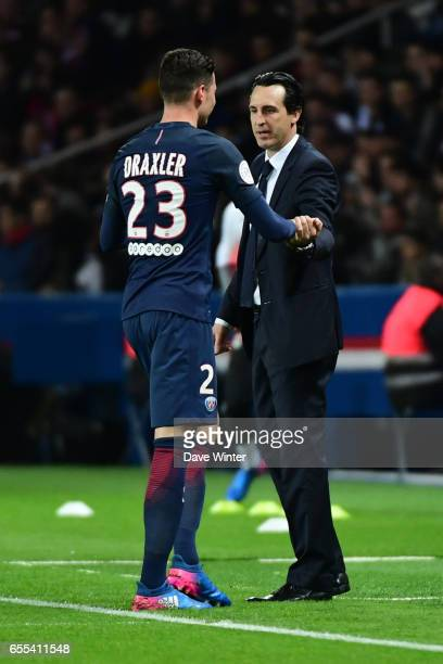 Julian Draxler of PSG is substituted by PSG coach Unai Emery during the French Ligue 1 match between Paris Saint Germain and Lyon at Parc des Princes...