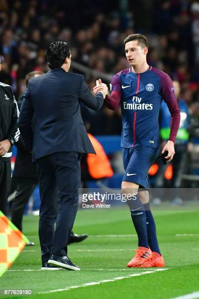 Julian Draxler of PSG is substituted by PSG coach Unai Emery during the UEFA Champions League match between Paris Saint Germain and Glasgow Celtic at...
