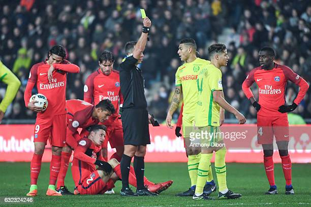 Julian Draxler of PSG looks injured while Diego Carlos Santos SIlva of Nantes receive a yellow card during the French Ligue 1 match between Nantes...