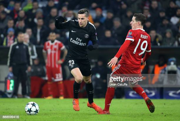 Julian Draxler of PSG Sebastian Rudy of Bayern Munich during the UEFA Champions League group B match between Bayern Muenchen and Paris SaintGermain...