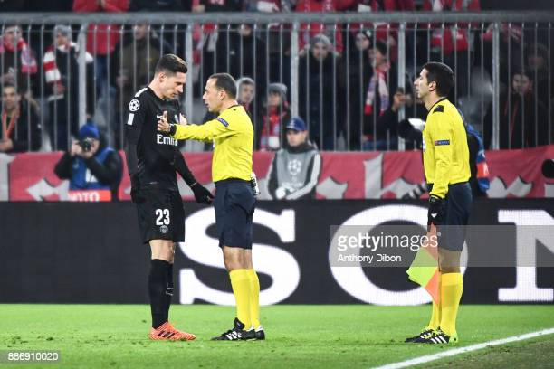 Julian Draxler of PSG talks with referees during the UEFA Champions League match between Bayern Munich and Paris Saint Germain at Allianz Arena on...