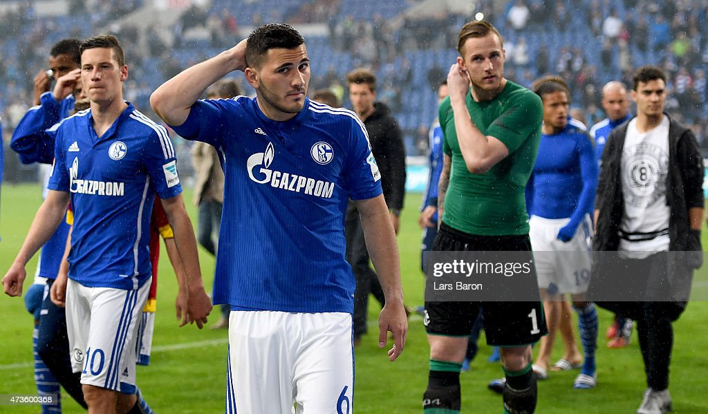 <a gi-track='captionPersonalityLinkClicked' href=/galleries/search?phrase=Julian+Draxler&family=editorial&specificpeople=7184479 ng-click='$event.stopPropagation()'>Julian Draxler</a> of Schalke 04, Sead Kolasinac of Schalke 04 and goalkeeper Ralf Fahrmann of Schalke 04 are seen with team mates after the Bundesliga match between FC Schalke 04 and SC Paderborn at Veltins Arena on May 16, 2015 in Gelsenkirchen, Germany.