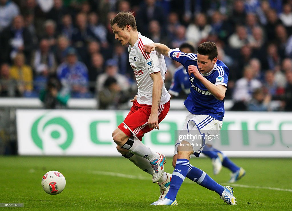 Julian Draxler (R) of Schalke and <a gi-track='captionPersonalityLinkClicked' href=/galleries/search?phrase=Marcell+Jansen&family=editorial&specificpeople=236023 ng-click='$event.stopPropagation()'>Marcell Jansen</a> of Hamburg compete for the ball during the Bundesliga match between FC Schalke 04 and Hamburger SV at Veltins-Arena on April 28, 2013 in Gelsenkirchen, Germany.