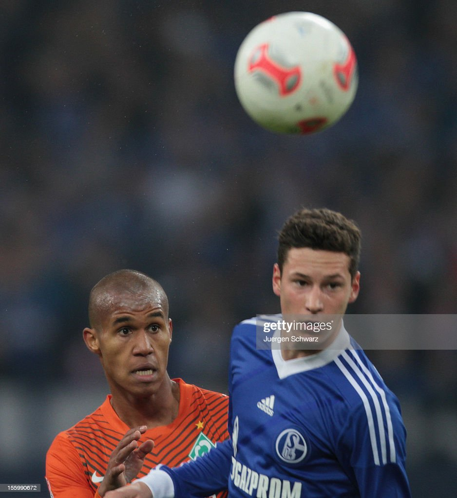 Julian Draxler of Schalke (R) and Theodor Gebre Selassie of Werder jump for the ball during the Bundesliga match between FC Schalke 04 and Werder Bremen at Veltins-Arena on November 10, 2012 in Gelsenkirchen, Germany.