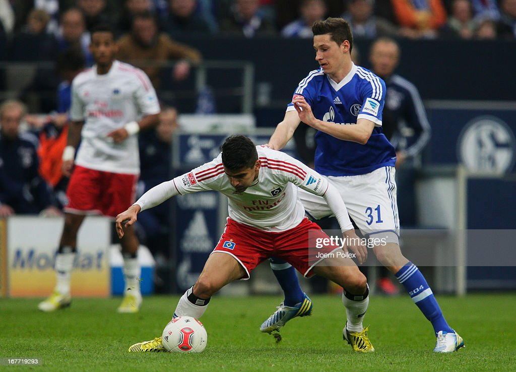 <a gi-track='captionPersonalityLinkClicked' href=/galleries/search?phrase=Julian+Draxler&family=editorial&specificpeople=7184479 ng-click='$event.stopPropagation()'>Julian Draxler</a> (R) of Schalke and <a gi-track='captionPersonalityLinkClicked' href=/galleries/search?phrase=Tomas+Rincon&family=editorial&specificpeople=1009045 ng-click='$event.stopPropagation()'>Tomas Rincon</a> of Hamburg compete for the ball during the Bundesliga match between FC Schalke 04 and Hamburger SV at Veltins-Arena on April 28, 2013 in Gelsenkirchen, Germany.