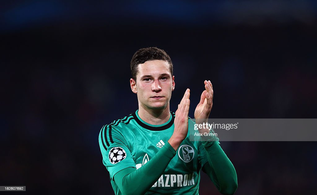 <a gi-track='captionPersonalityLinkClicked' href=/galleries/search?phrase=Julian+Draxler&family=editorial&specificpeople=7184479 ng-click='$event.stopPropagation()'>Julian Draxler</a> of Schalke celebrates after the UEFA Champions League Group E match between FC Basel 1893 and FC Schalke 04 at St. Jakob-Park on October 1, 2013 in Basel, Switzerland.