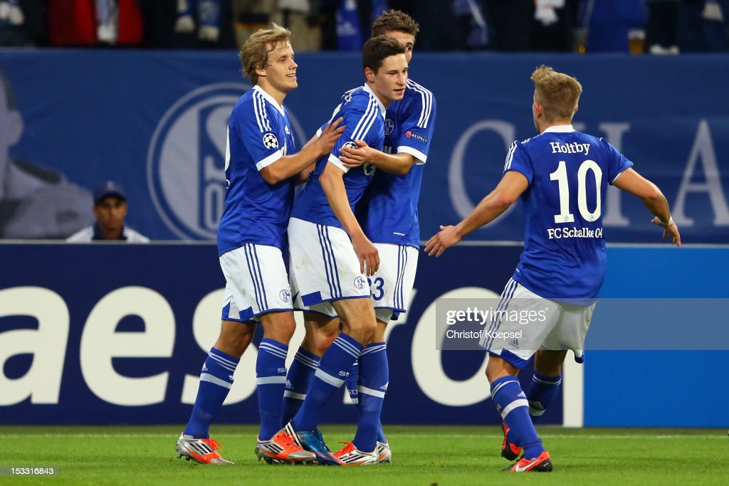 <a gi-track='captionPersonalityLinkClicked' href=/galleries/search?phrase=Julian+Draxler&family=editorial&specificpeople=7184479 ng-click='$event.stopPropagation()'>Julian Draxler</a> of Schalke (2nd L) celebrates the first goal with Teemu Pukki (L), <a gi-track='captionPersonalityLinkClicked' href=/galleries/search?phrase=Roman+Neustaedter&family=editorial&specificpeople=5437402 ng-click='$event.stopPropagation()'>Roman Neustaedter</a> (2nd R) and <a gi-track='captionPersonalityLinkClicked' href=/galleries/search?phrase=Lewis+Holtby&family=editorial&specificpeople=5351202 ng-click='$event.stopPropagation()'>Lewis Holtby</a> of Schalke during the UEFA Champions League group B match between FC Schalke 04 and Montpellier Herault SC at Veltins-Arena on October 3, 2012 in Gelsenkirchen, Germany.
