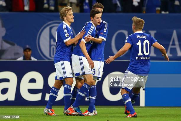 Julian Draxler of Schalke celebrates the first goal with Teemu Pukki Roman Neustaedter and Lewis Holtby of Schalke during the UEFA Champions League...