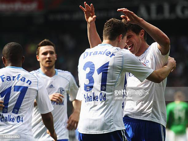 Julian Draxler of Schalke celebrates with his team mate KlaasJan Huntelaar after scoring his team's first goal during the Bundesliga match between SV...