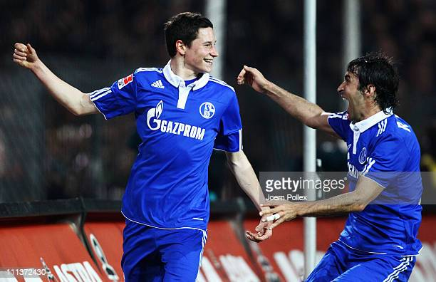 Julian Draxler of Schalke celebrates with his team mate Raul after scoring his team's second goal during the Bundesliga match between FC St Pauli and...