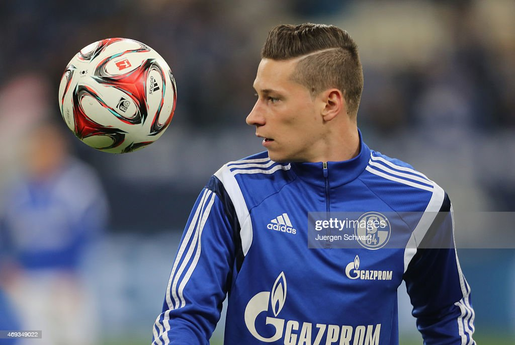 <a gi-track='captionPersonalityLinkClicked' href=/galleries/search?phrase=Julian+Draxler&family=editorial&specificpeople=7184479 ng-click='$event.stopPropagation()'>Julian Draxler</a> of Schalke eyes the ball during the warm up of the Bundesliga match between Schalke 04 and SC Freiburg at Veltins Arena on April 11, 2015 in Gelsenkirchen, Germany.