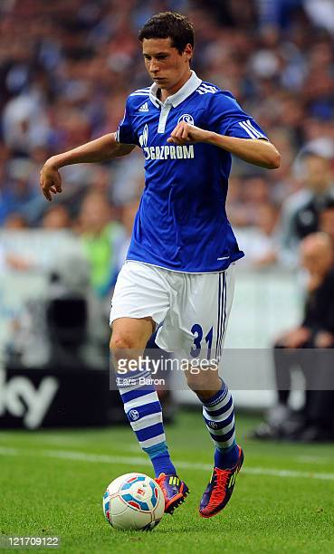 Julian Draxler of Schalke gesturesl during the Bundesliga match between FC Schalke 04 and 1 FC Koeln at Veltins Arena on August 13 2011 in...