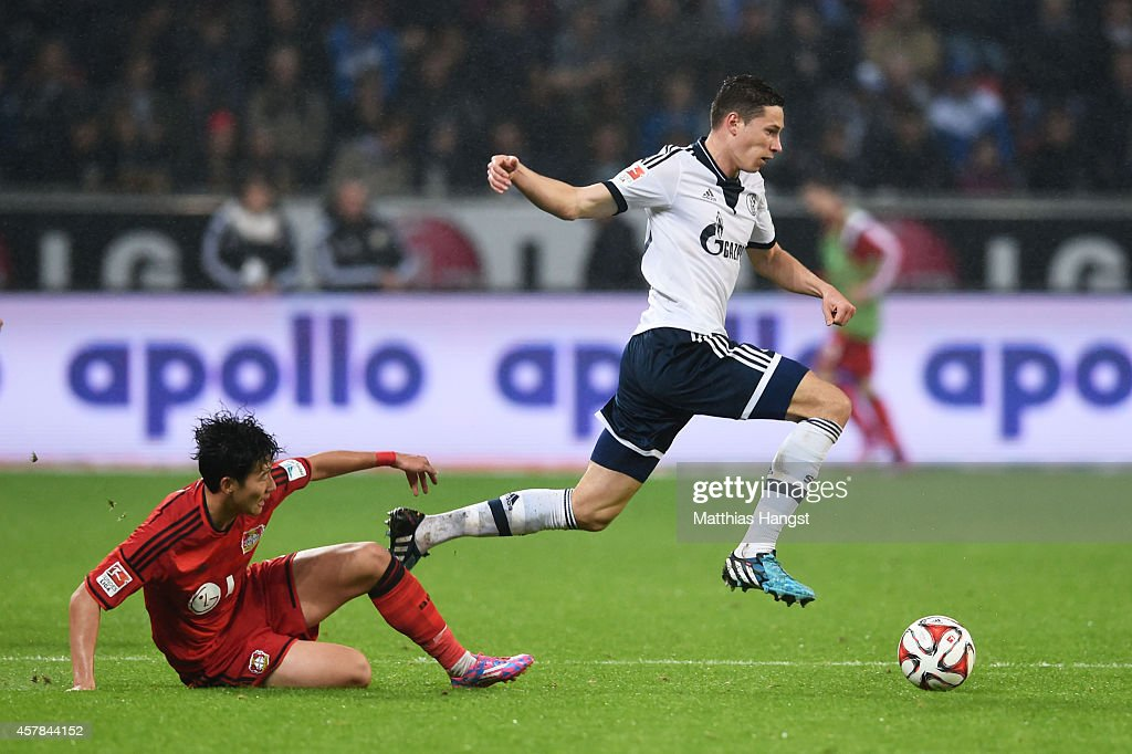 <a gi-track='captionPersonalityLinkClicked' href=/galleries/search?phrase=Julian+Draxler&family=editorial&specificpeople=7184479 ng-click='$event.stopPropagation()'>Julian Draxler</a> of Schalke goes past the challenge from Son Heung-Min of Bayer Leverkusen during the Bundesliga match between Bayer 04 Leverkusen and FC Schalke 04 at BayArena on October 25, 2014 in Leverkusen, Germany.
