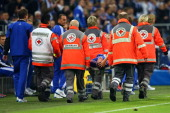 Julian Draxler of Schalke is carried off the pitch after an injury during the UEFA Champions League group B match between FC Schalke 04 and...