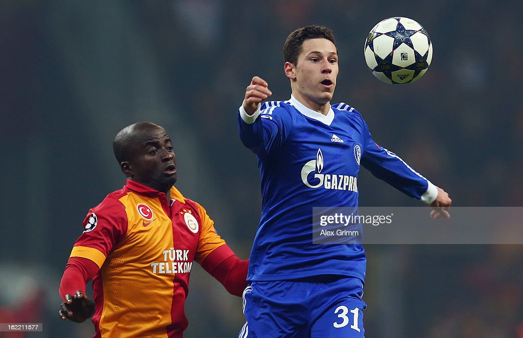 Julian Draxler (R) of Schalke is challenged by Dany Nounkeu of Galatasaray during the UEFA Champions League Round of 16 first leg match between Galatasaray and FC Schalke 04 at the Turk Telekom Arena on February 20, 2013 in Istanbul, Turkey.