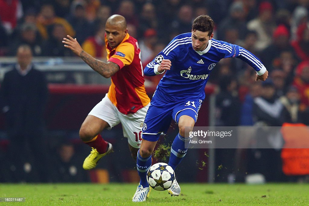 Julian Draxler of Schalke is challenged by Felipe Melo of Galatasaray during the UEFA Champions League Round of 16 first leg match between Galatasaray and FC Schalke 04 at the Turk Telekom Arena on February 20, 2013 in Istanbul, Turkey.