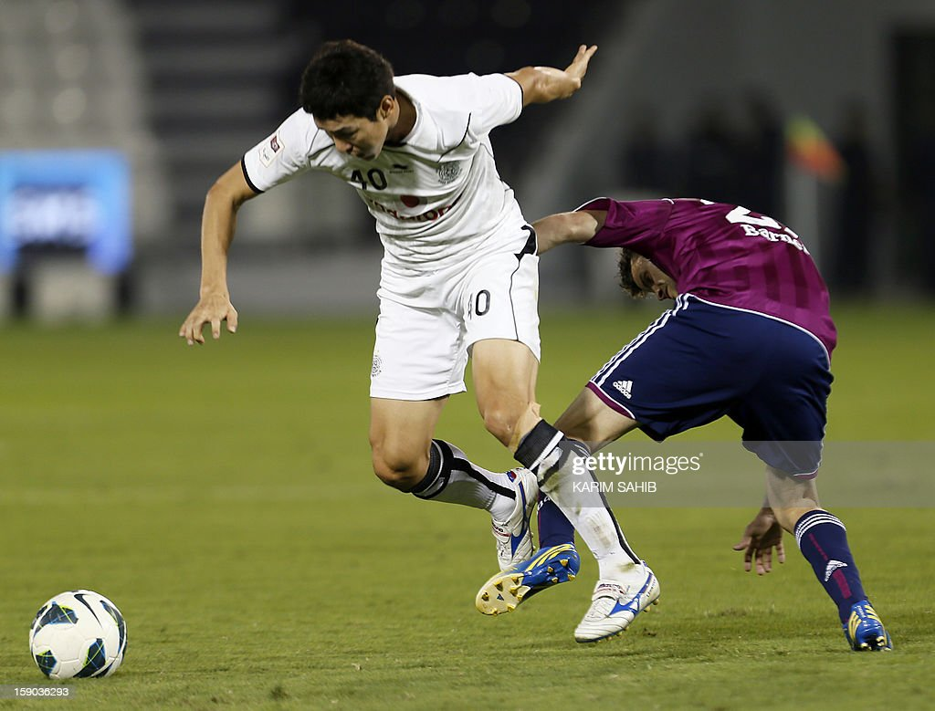 Julian Draxler (R) of Schalke is challenged by Jung Soo Lee of Qatar's al-Sadd, during their friendly football match in Doha on January 6, 2013. Schalke is in Qatar for a week-long training camp before the beginning of the new season of the German Bundesliga after the winter break.