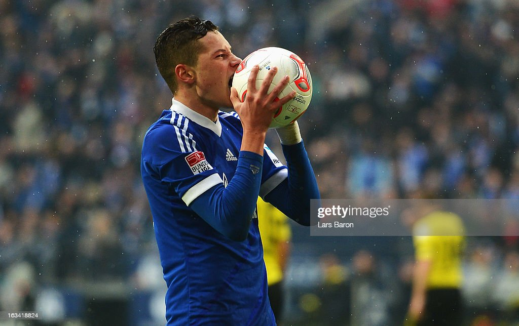 <a gi-track='captionPersonalityLinkClicked' href=/galleries/search?phrase=Julian+Draxler&family=editorial&specificpeople=7184479 ng-click='$event.stopPropagation()'>Julian Draxler</a> of Schalke reacts during the Bundesliga match between FC Schalke 04 and Borussia Dortmund at Veltins-Arena on March 9, 2013 in Gelsenkirchen, Germany.