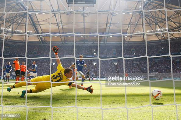 Julian Draxler of Schalke shoots and scores his teams first goal of the game past Goalkeeper Christian Mathenia of Darmstadt during the Bundesliga...