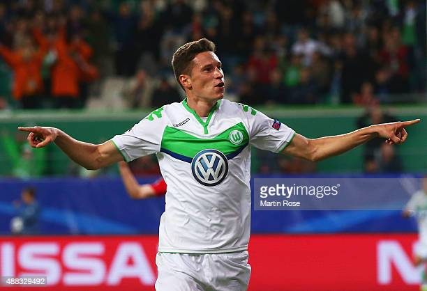 Julian Draxler of VfL Wolfsburg celebrates as he scores their first goal during the UEFA Champions League Group B match between VfL Wolfsburg and PFC...