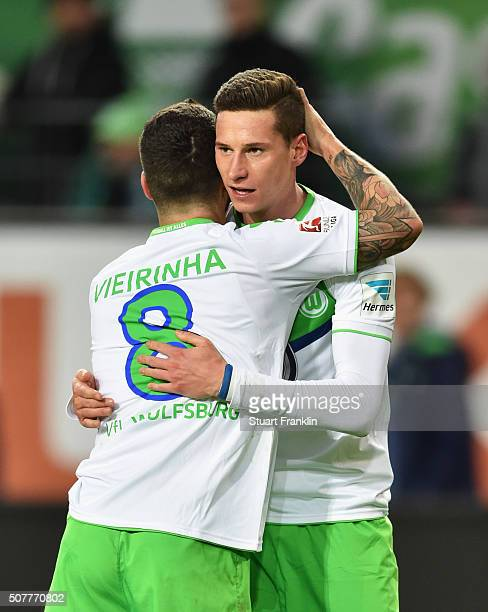Julian Draxler of VfL Wolfsburg celebrates with Vierinha as he scores their first goal during the Bundesliga match between VfL Wolfsburg and 1 FC...