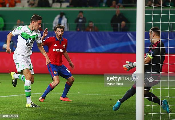 Julian Draxler of VfL Wolfsburg shoots past goalkeeper Igor Akinfeev of CSKA Moscow to score their first goal during the UEFA Champions League Group...