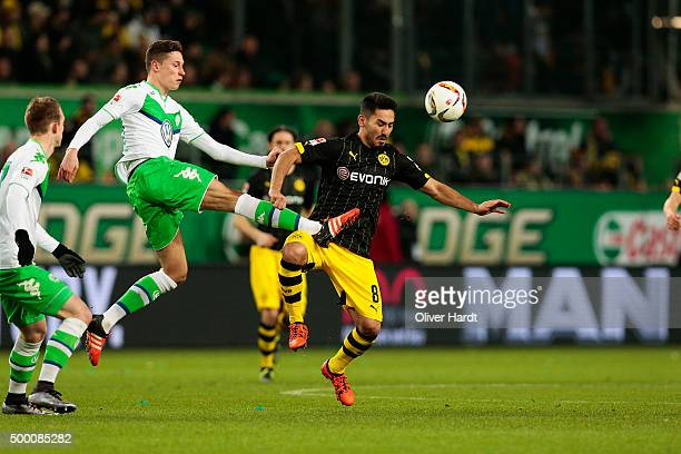 Julian Draxler of Wolfsburg and Ilkay Guendogan of Dortmund compete for the ball during the First Bundesliga match at between VfL Wolfsburg and...